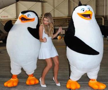 Sarah Hyland dances with penguins at Delta holiday party