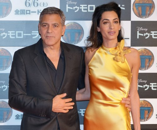 Amal Clooney stuns in gold gown at 'Tomorrowland' premiere