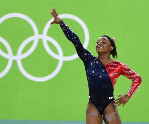 Olympian Simone Biles has a life-size cutout of Zac Efron