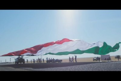 Truck pulls giant Kuwaiti flag to break Guinness World Record