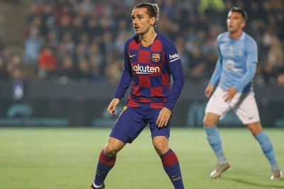 Copa del Rey soccer: Griezmann scores twice, Barcelona survives underdog Ibiza