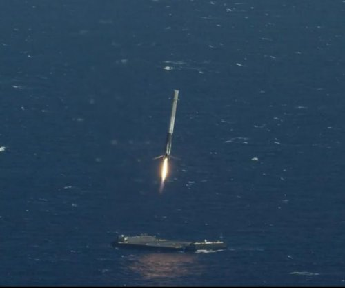 Rocket landing at sea marks success for SpaceX
