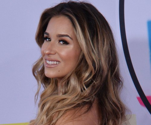 Jessie James Decker holds 'chubby cheeked' son Forrest in new photo