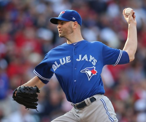J.A. Happ pitches Toronto Blue Jays past New York Yankees