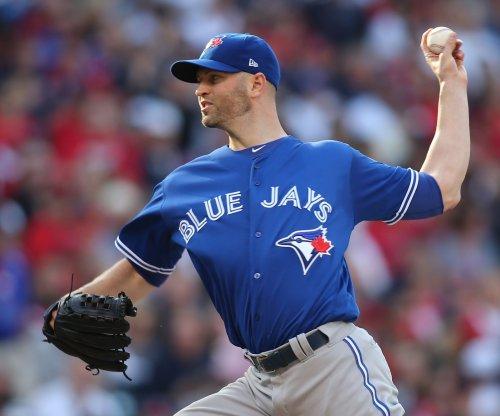 J.A. Happ pitches Toronto Blue Jays past New York Yankees