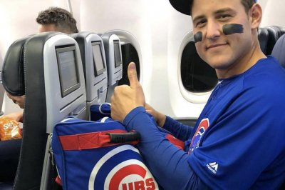 Chicago Cubs' Anthony Rizzo wears full uniform on team plane