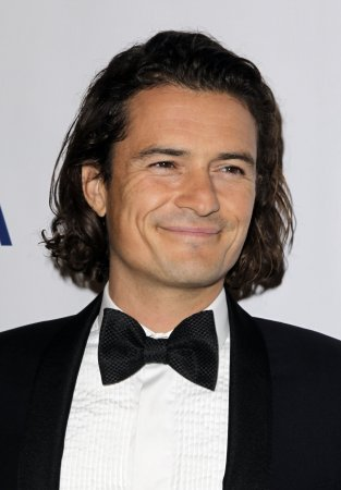 Orlando Bloom reportedly wooing Margot Robbie