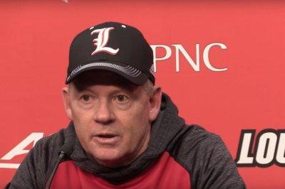 Kentucky stuns No. 11 Louisville, 41-38