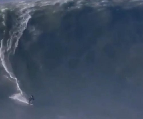 Andrew Cotton: British big-wave surfer breaks back in terrifying wipeout
