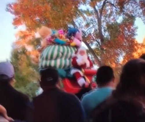 Santa ejected from sleigh during Disneyland parade