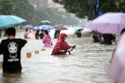 , Death toll in China's Henan Province at 302 after flash floods, Forex-News, Forex-News