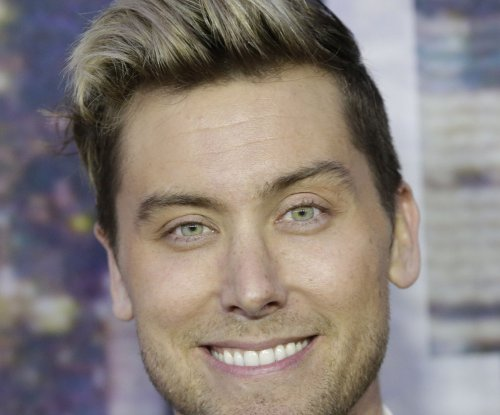 Lance Bass denies hooking up with Andy Cohen