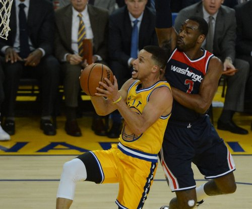 Golden State Warriors whip Washington Wizards for 11th straight win