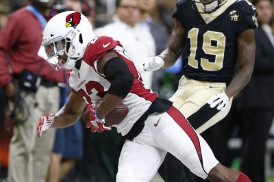Cardinals release starters CB Bene Benwikere, OT Andre Smith