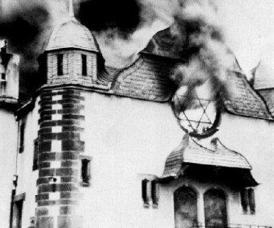 Nazis burn synagogues, smash stores as German police watch