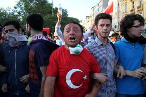 Istanbul calm; police lob tear gas at protesters in Ankara