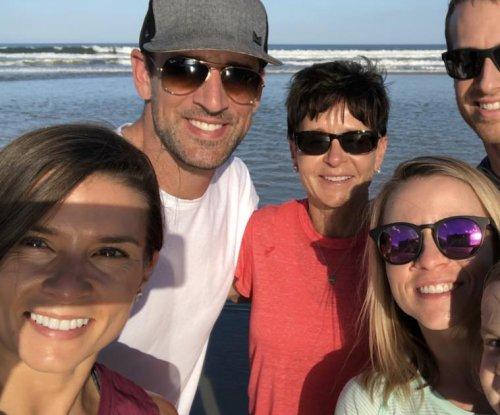 Aaron Rodgers, Danica Patrick go public with Daytona 500 photo, kiss