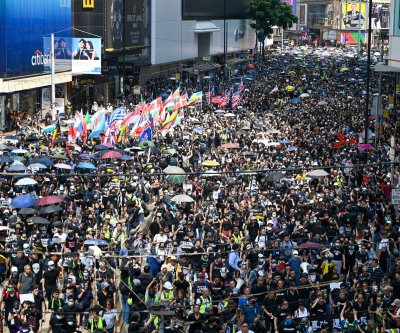 U.S. commission: Strip Hong Kong of special status if China interferes with protests