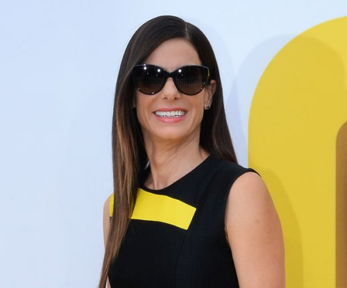 Sandra Bullock wears 'Minions' shoes to movie's premiere