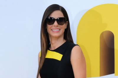Sandra Bullock wears 'Minions' shoes to movie's premiere
