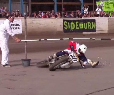 Motorcyclist shows off limbo skills, touches handlebars to ground