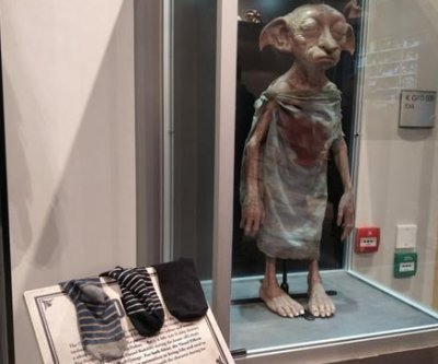 Harry Potter fans 'trying to free' Dobby with socks in London