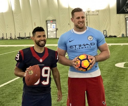 Houston Texans' J.J. Watt meets Manchester City star, wears tiny jersey