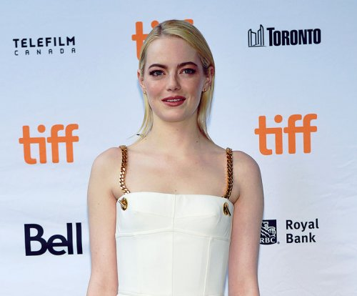 Emma Stone wears tennis whites to 'Battle of the Sexes' premiere