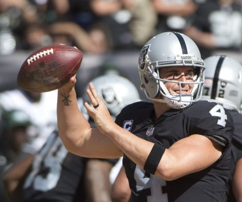 Carr hits Crabtree with no time left as Raiders drop Chiefs