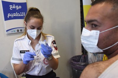 Israel begins drive to give COVID-19 vaccine to 100K Palestinian workers