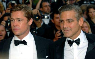 Costumer happy to dress Clooney, Pitt