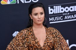 Demi Lovato sings from hospital bed in 'Dancing with the Devil' music video teaser