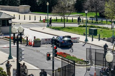 Officer, suspect dead after car rams into Capitol barricade
