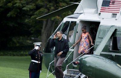 Obama visits Wisconsin, California