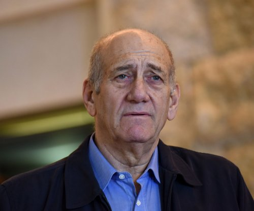 Former Israeli PM Olmert given 18-month reduced sentence