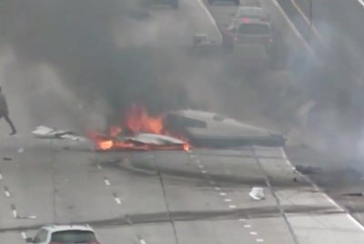 Plane crashes into California highway, erupts into flames