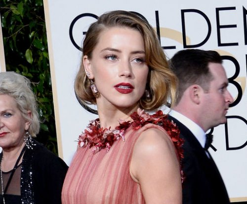 Amber Heard on Elon Musk split: We 'care deeply for one another'