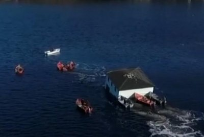 Newfoundland couple float their dream home across inlet