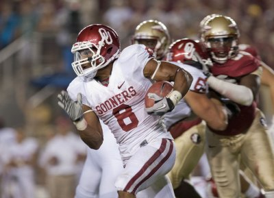Sooners suspend four football players