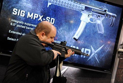 Gun advocates split with NRA on checks