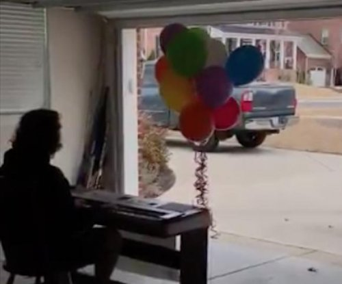Teen performs 'UP' theme in Pixar promposal