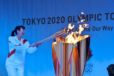 Japan nixes plan for Olympic torch relay amid COVID-19 surge