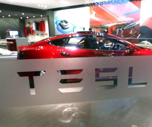 Tesla's mass-market Model 3 begins production Friday
