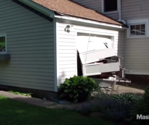 Grandpa crashes car through garage door for 'bucket list'