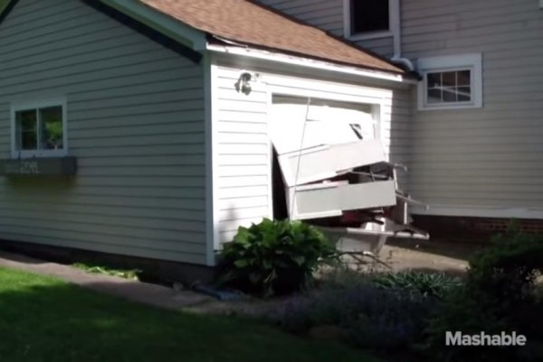 Watch man 91 crashes through garage door on purpose for 1 5 car garage