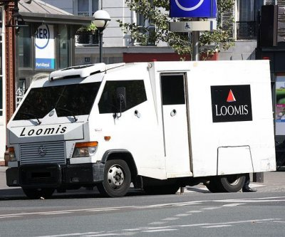 FBI finds $600K in back yard of armored truck driver