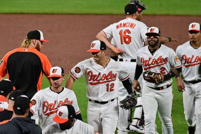Orioles outfielder records save in 16-inning win vs. Angels