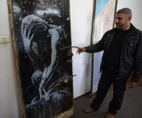 Police seize Banksy mural bought from Palestinian man for $175