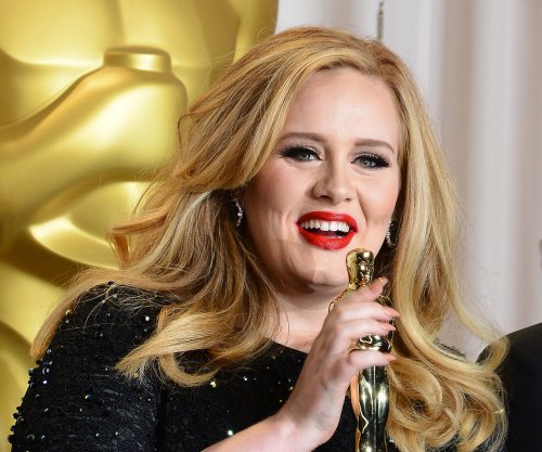 Adele puts Beyonce rejection rumors to rest, dishes on '25'