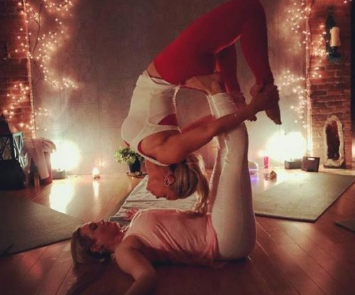 Coco Austin performs acroyoga with sister Kristy